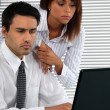 Business couple with strong work ethic - Stock Photo