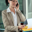 Business-worker looking at document during call — Stock Photo #15991789