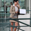 Businesswoman on the phone outside an office — Stock Photo #15991929