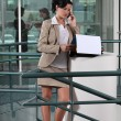 Stock Photo: Businesswomon phone outside office