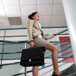 Stock Photo: Businesswomwith briefcase climbing stairs