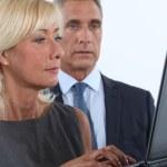 Middle-aged couple using laptop — Stock Photo