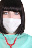 Vrouw in scrubs en medische masker — Stockfoto