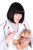 Female doctor injecting a teddy bear — Stock Photo
