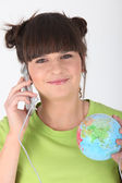 Woman making telephone call and holding globe Godreau_Lea_140410 — Stock Photo