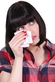 Brunette with tissue — Stock Photo