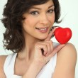 Woman holding a heart — Stock Photo