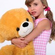 Royalty-Free Stock Photo: Little girl holding giant teddy bear
