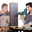 Little boy and girl with power tools — Stock fotografie