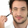Man applying make-up — Stock Photo #16015995