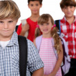 Schoolchildren with bags - Stockfoto