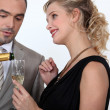 Woman serving champagne — Stock Photo