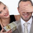 Couple with a surprise gift — Stock Photo