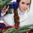 Young woman stood by Christmas tree — Stock Photo #16017053