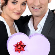 Romantic couple with heart-shaped box — Stock Photo