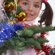 Girl behind a Christmas tree - 图库照片