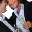 Couple having a celebratory drink - Stock Photo
