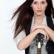 Cool woman with a guitar — Stock Photo