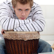 Mwith his arms on his drum — Stock Photo #16017633
