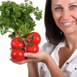 Woman holding tomatoes — Stock Photo #16018045