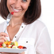 Woman with bowl of fruit salad — Stock Photo #16018057