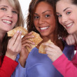 Three friends eating pancakes — Stock Photo