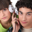 Couple sharing headphones — Stock Photo