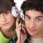 Couple sharing headphones — Stock Photo