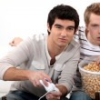 Young men hooked on a video game - Stock Photo
