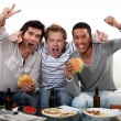 Royalty-Free Stock Photo: Three friends eating while watching television