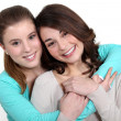 Stock Photo: Two young women in friendly hug