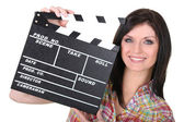 Woman with movie slate — Stock Photo