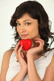 Young woman holding a plastic hearth in her hand — Stock Photo