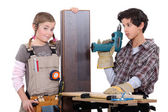 Little boy and girl with power tools — Stock Photo