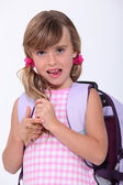 Young schoolgirl with a rucksack — Stock Photo