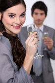 Young couple celebrating event with champagne — Stock Photo