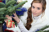 Young woman under a Christmas tree — Stock Photo