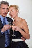 Mature couple toasting with champagne — Stock Photo