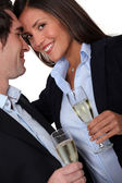 Couple having a celebratory drink — Stock Photo