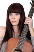 Busker posing with her guitar — Stock Photo