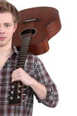 Young man with an acoustic guitar — Stock Photo