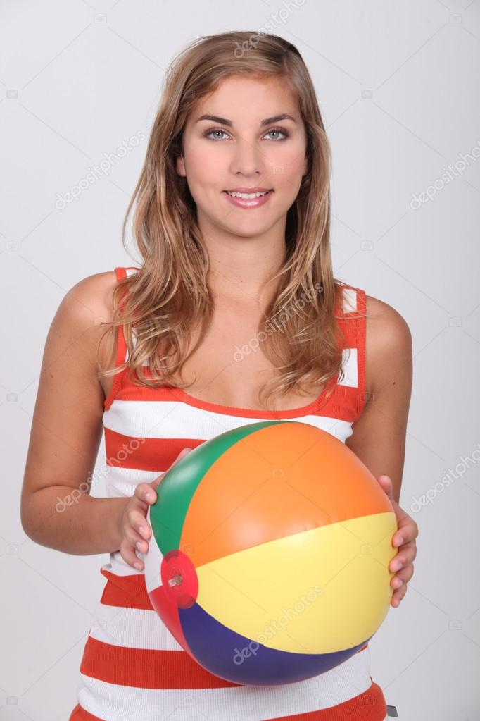 Young blond woman holding beach ball — Stock Photo #16016143