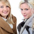 Two blonde women with shelter — Stock Photo