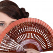 Woman holding fan — Stock Photo