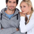 Couple in tracksuit — Stock Photo