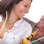 Couple eating fruit — Stock Photo #16026547