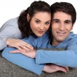 Stock Photo: Couple sitting on a sofa