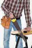 Closeup on tradesman handling saw — Stock Photo