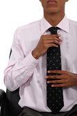 Man adjusting his tie — Stock Photo