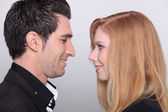 Man and woman standing face to face — Stock Photo